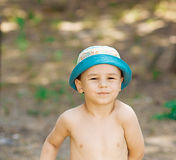 Outdoor close up portrait of little boy in a hat. Background, one person, child, 4-5 years old. Outdoor close up portrait of little boy in a hat. Background Stock Photography