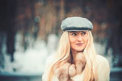 Outdoor close up portrait of young beautiful fashionable woman posing in street. Model wearing grey beret. Female stock photography