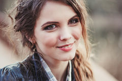 Outdoor close up portrait of young smiling beautiful woman with natural make up Royalty Free Stock Image
