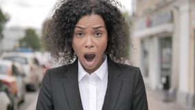 Outdoor Close Up of Shocked Young Businesswoman Standing Outdoor on Footpath stock footage