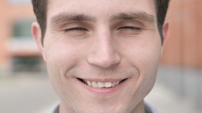 Outdoor close up of smiling young man stock video footage