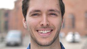 Outdoor Close up of  Smiling Young Man. 4k high quality, 4k high quality stock footage