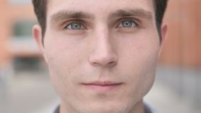 Outdoor close up of young man face stock video footage