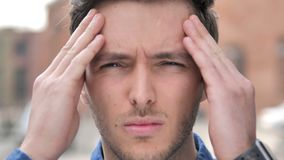 Outdoor Close up of Young Man with Headache. 4k high quality, 4k high quality stock footage
