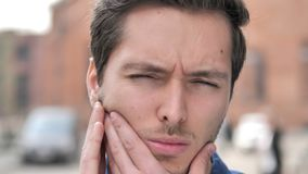 Outdoor Close up of Young Man with Toothache. 4k high quality, 4k high quality stock video