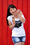 Outdoor closeup fashion portrait of young hipster crazy girl eating ice cream in summer hot weather, having fun and good mood. Pic Stock Photo