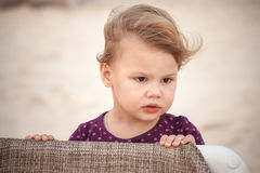 Outdoor closeup portrait of cute serious baby girl Stock Photo