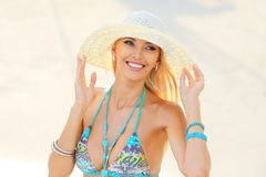Outdoor closeup portrait of young pretty smiling sensual blonde Stock Photography