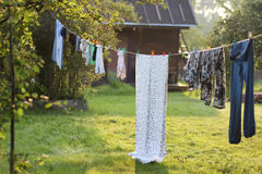 Outdoor clothesline clothespin. In autumn rustic landscape Royalty Free Stock Images