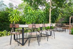 Outdoor coffee corner, outdoor cafe, chairs and tables in coffee shop. An outdoor cooffee shop in Pakchong Nakorn Ratchasima, Thailand royalty free stock photo