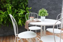 Outdoor coffee table. Vintage outdoor coffee table in cafe wooden terrace stock photography