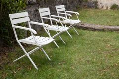 Outdoor collapsible wooden chairs. Many outdoor collapsible wooden chairs Royalty Free Stock Photography