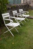 Outdoor collapsible wooden chairs. Three outdoor collapsible wooden chairs Stock Photo