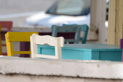 Outdoor colourful wooden chairs and tables Stock Images