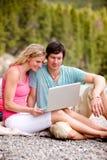 Outdoor Computer Couple Royalty Free Stock Photos