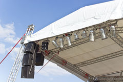 Outdoor concert stage roof construction with speakers Royalty Free Stock Photo