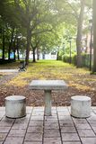 Outdoor concrete chess table in a public park. Outdoor concrete chess table and two seats in a public park in Montreal, Canada royalty free stock images
