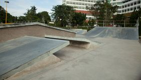 Free Outdoor Concrete Skateboard Ramp At The Park Royalty Free Stock Photos - 105527738