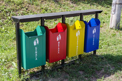 Outdoor containers for sorting waste. Colorful street containers for sorting waste-shirts by Category: Paper; Metal; Plastic; Glass royalty free stock image