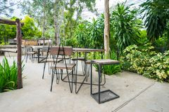 Outdoor coffee corner, outdoor cafe, chairs and tables in coffee shop. An outdoor cooffee shop in Pakchong Nakorn Ratchasima, Thailand royalty free stock photos