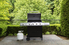 Outdoor cooker with lid in open position on home patio Stock Photo