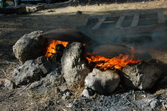 Outdoor Cooking. A metal round plate on fire camp for cooking pita bread in the middle east royalty free stock images