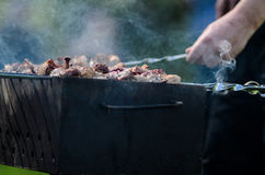 Outdoor Cooking. Cooking on the barbecue grill. Outdoor weekend time Royalty Free Stock Image