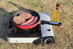 Outdoor cooking Stock Images