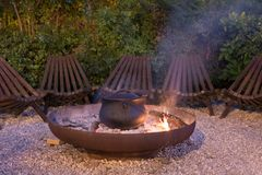 Outdoor cooking. Camp fire outdoor cooking pot Royalty Free Stock Images