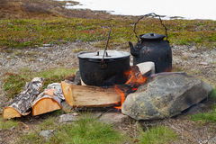 Outdoor cooking on campfire. Royalty Free Stock Photos