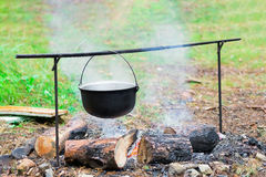 Outdoor cooking on a campfire. In summer forest Stock Image