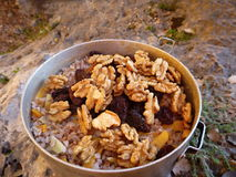 Outdoor cooking in a campsite. Under a rock stock images