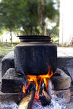 Outdoor cooking. On heat of woods Royalty Free Stock Photography