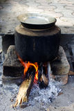 Outdoor cooking. On heat of woods Royalty Free Stock Photos