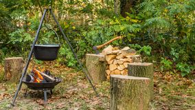 Outdoor cooking on open fire stock photo