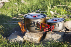 Outdoor Cooking. Pots sit atop a stone fire pit for outdoor cooking Royalty Free Stock Images