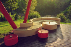 Outdoor couch on wooden floor Royalty Free Stock Images