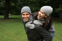 Outdoor couple. Laughing couple in the park stock photo