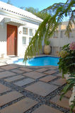 Outdoor courtyard. House courtyard to swimming pool with cobblestones Royalty Free Stock Photography