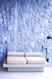 Outdoor cozy sofa furniture with rocky texture. Background Royalty Free Stock Images