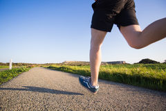 Outdoor cross-country running in summer sunshine concept for exercising, fitness and healthy lifestyle stock photo