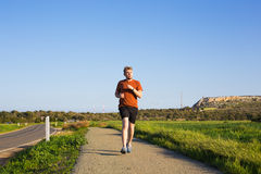 Outdoor cross-country running in summer sunshine concept for exercising, fitness and healthy lifestyle Royalty Free Stock Image