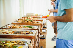 Outdoor Cuisine Culinary Buffet Dinner Catering. Group of people in all you can eat. Dining Food Celebration Party Concept. Servic. E at business meeting royalty free stock image