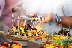 Outdoor Cuisine Culinary Buffet Dinner Catering. Group of people in all you can eat. Dining Food Celebration Party Concept. Service at business meeting royalty free stock photo