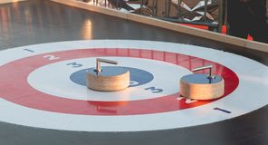 Outdoor curling track installed on a Christmas market. In France Stock Photography