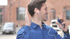 Outdoor Dancing Young Man Listening Music on Smartphone. 4k high quality, 4k high quality stock video
