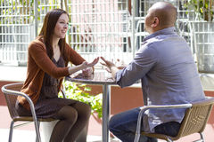 Outdoor Date. Interracial couple meeting on a casual first date outdoors Stock Images