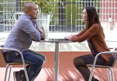 Outdoor Date. Interracial couple meeting on a casual first date outdoors Stock Photo