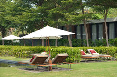 Outdoor daybeds with white parasol Royalty Free Stock Photography
