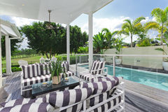 Outdoor deck and swimming pool stock images